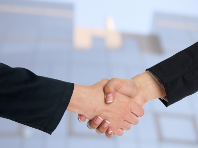 0132-handshaking_business_people.jpg