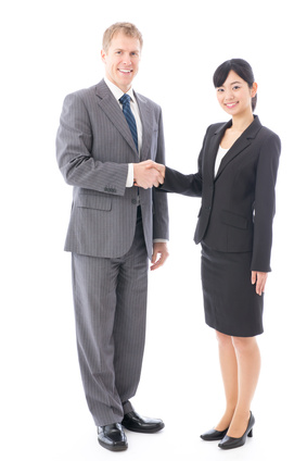 0135-handshaking_business_people.jpg