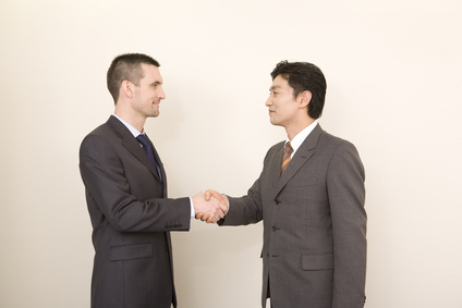 0135-handshaking_businessmen.jpg
