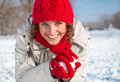 0187-happy_young_woman_playing_snowball_fight.jpg