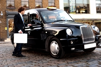 0385-businessman_interacting_with_taxi_driver.jpg