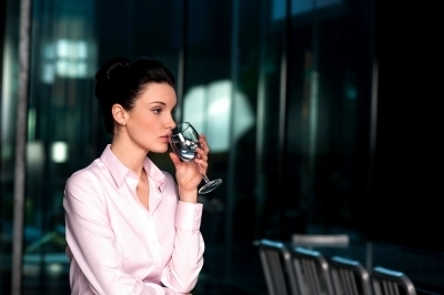 0390-thoughtful_corporate_woman_drinking_water.jpg