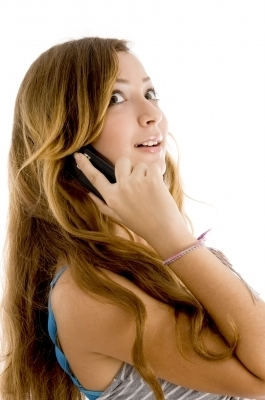 0451-teenage_girl_talking_over_mobile.jpg