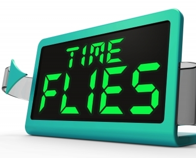 0308-time_flies_clock_busy_and_goes_by_quickly.jpg
