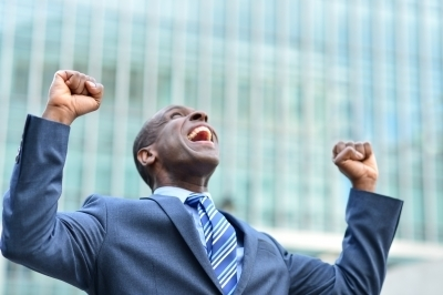 0325-excited_businessman_raising_his_arms.jpg