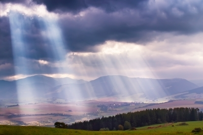 0397-sunlight_beams_over_clouds_in _mountains.jpg